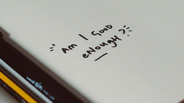 Am I good enough written on a note