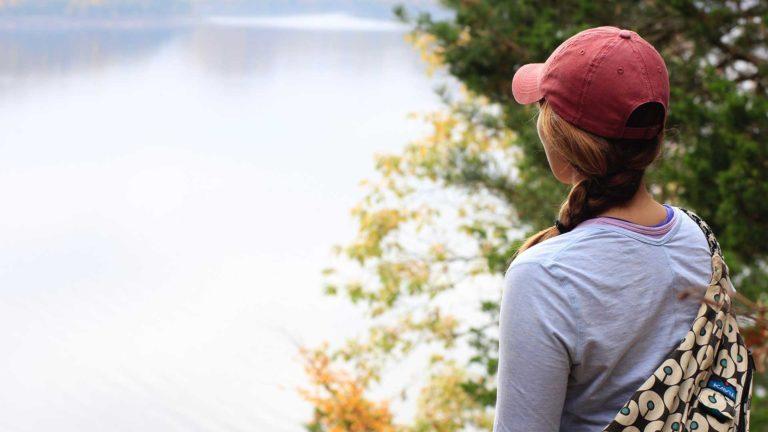 Single woman looking at lake