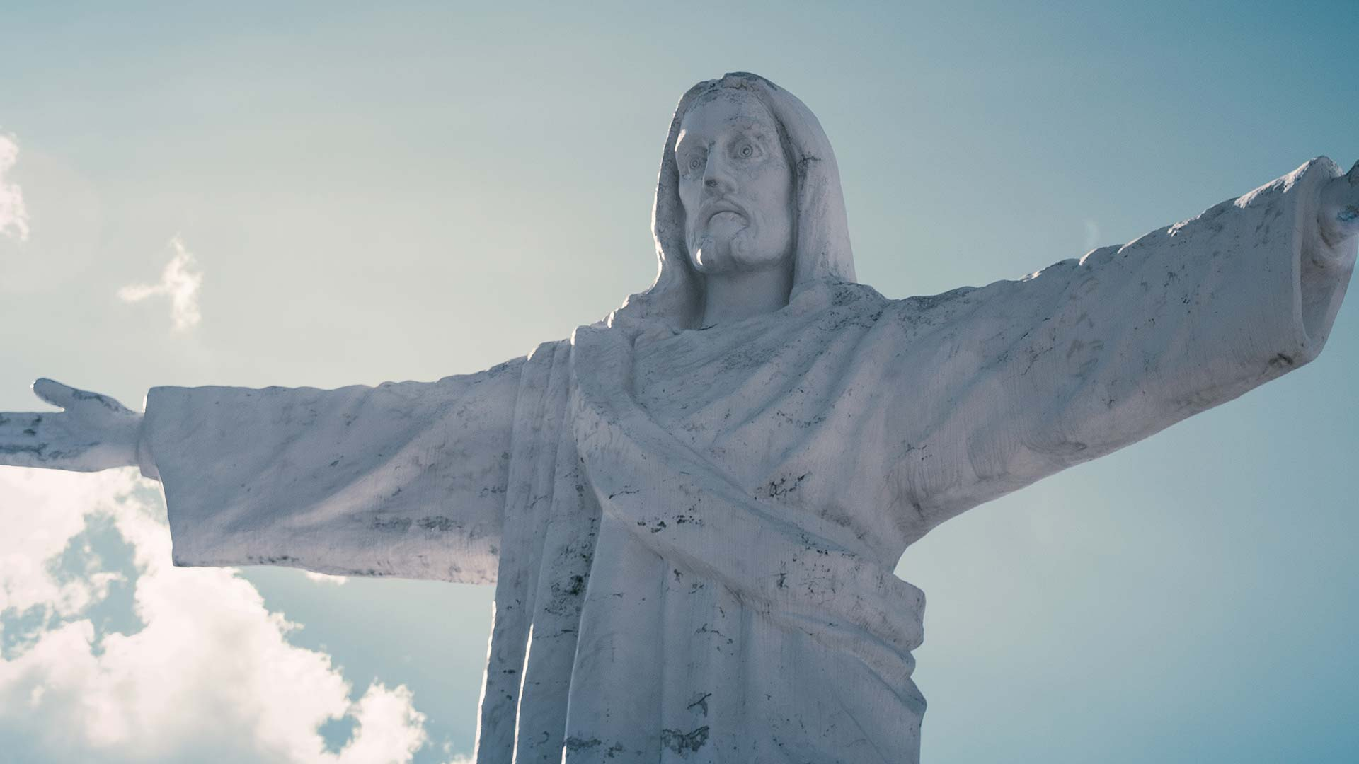 Jesus statue with outstretched hands