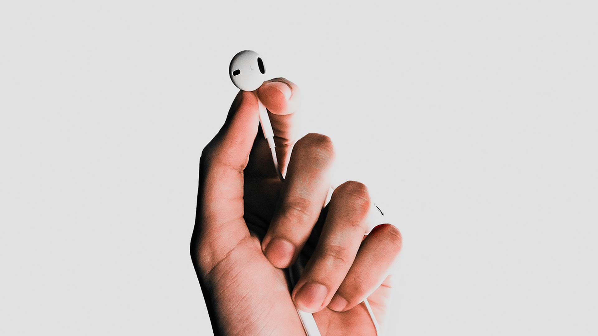 Hand holding earbud