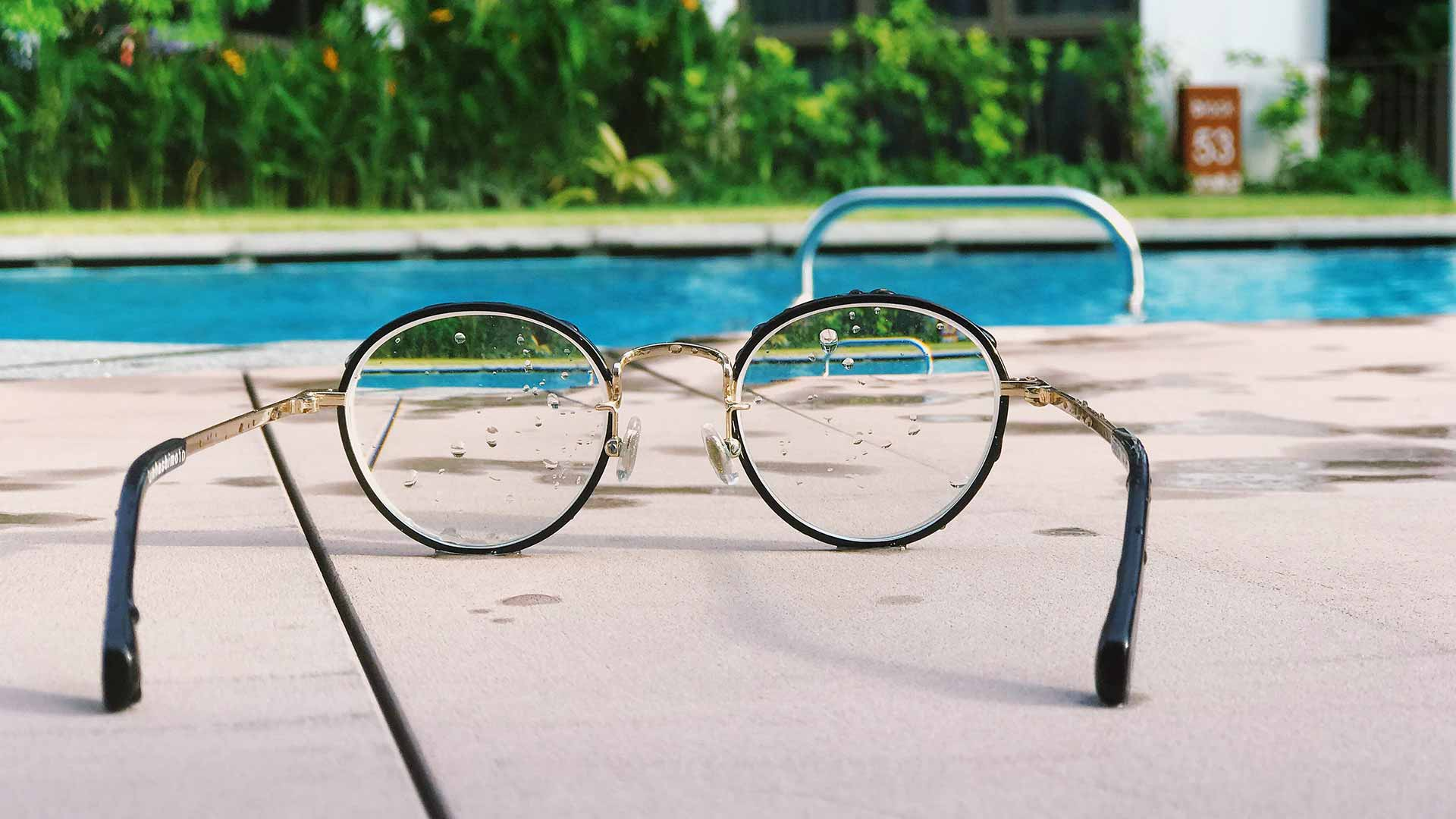Glasses by a pool