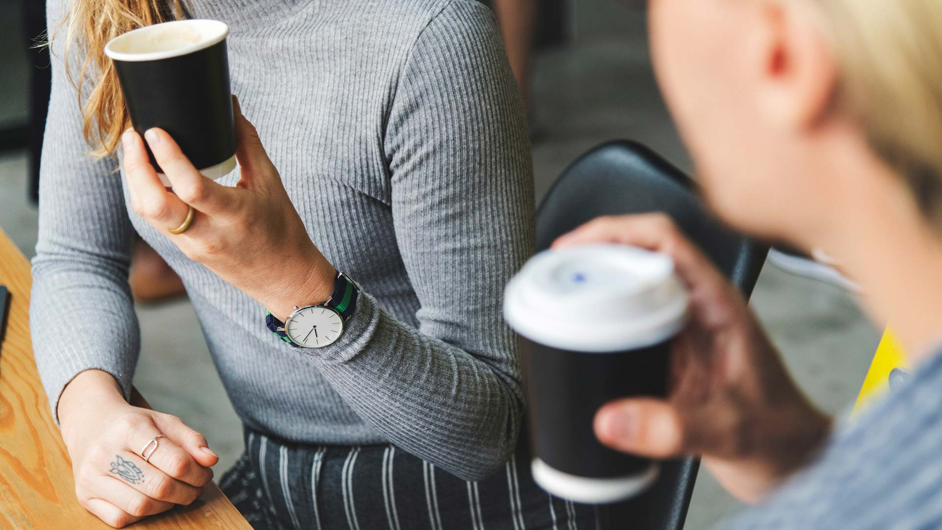 Ladies talking with coffee cups in hands