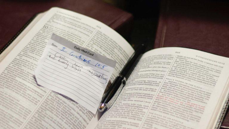 Open Bible with written verse
