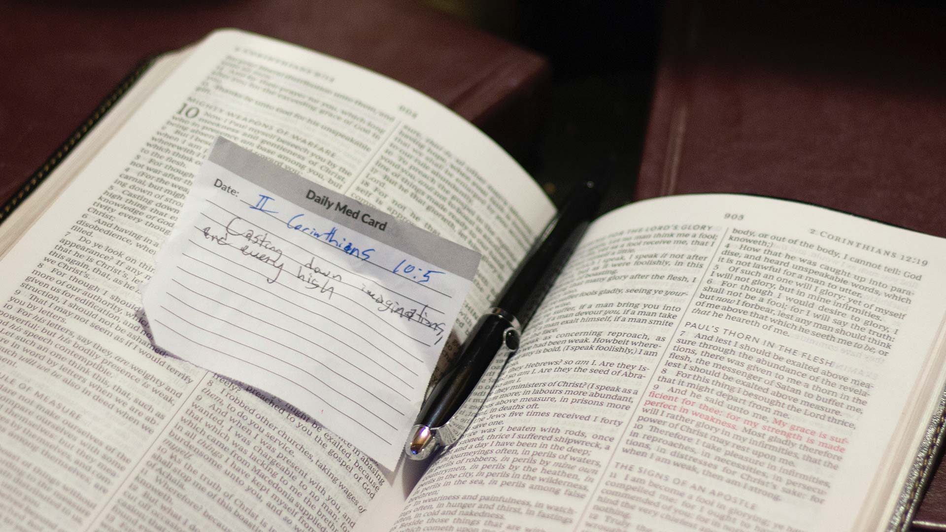 Open Bible with written verse