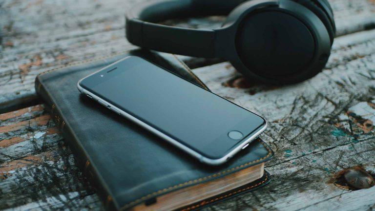 Bible, iPhone and headphones