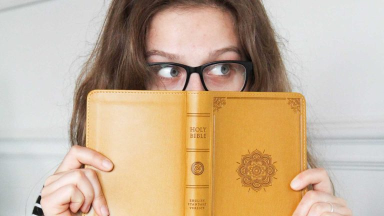 Lady with Bible over half of face