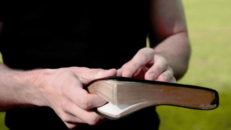 Man holds Bible