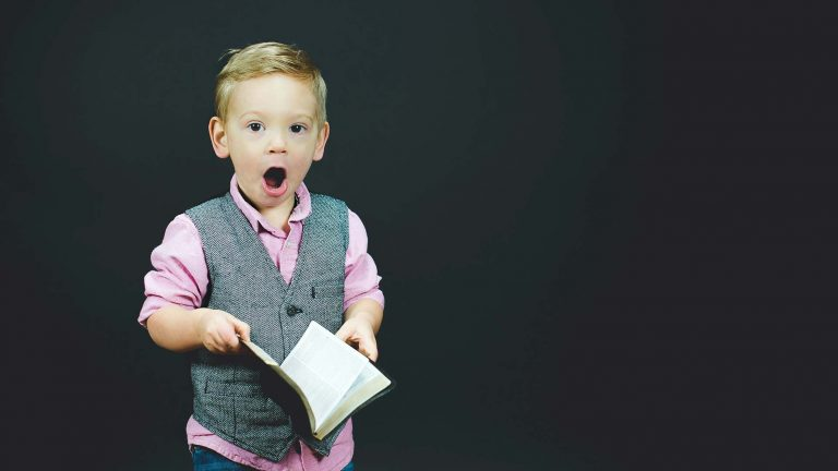 Surprised child with open Bible